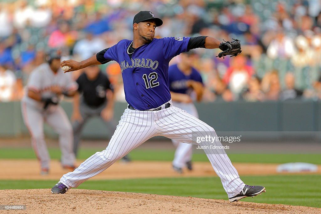 Relief pitcher <a gi-track='captionPersonalityLinkClicked' href=/galleries/search?phrase=Juan+Nicasio&family=editorial&specificpeople=6889135 ng-click='$event.stopPropagation()'>Juan Nicasio</a> #12 of the Colorado Rockies delivers to home plate during the seventh inning against the San Francisco Giants at Coors Field on September 1, 2014 in Denver, Colorado. The Rockies defeated the Giants 10-9 on a walk-off single by Charlie Blackmon.