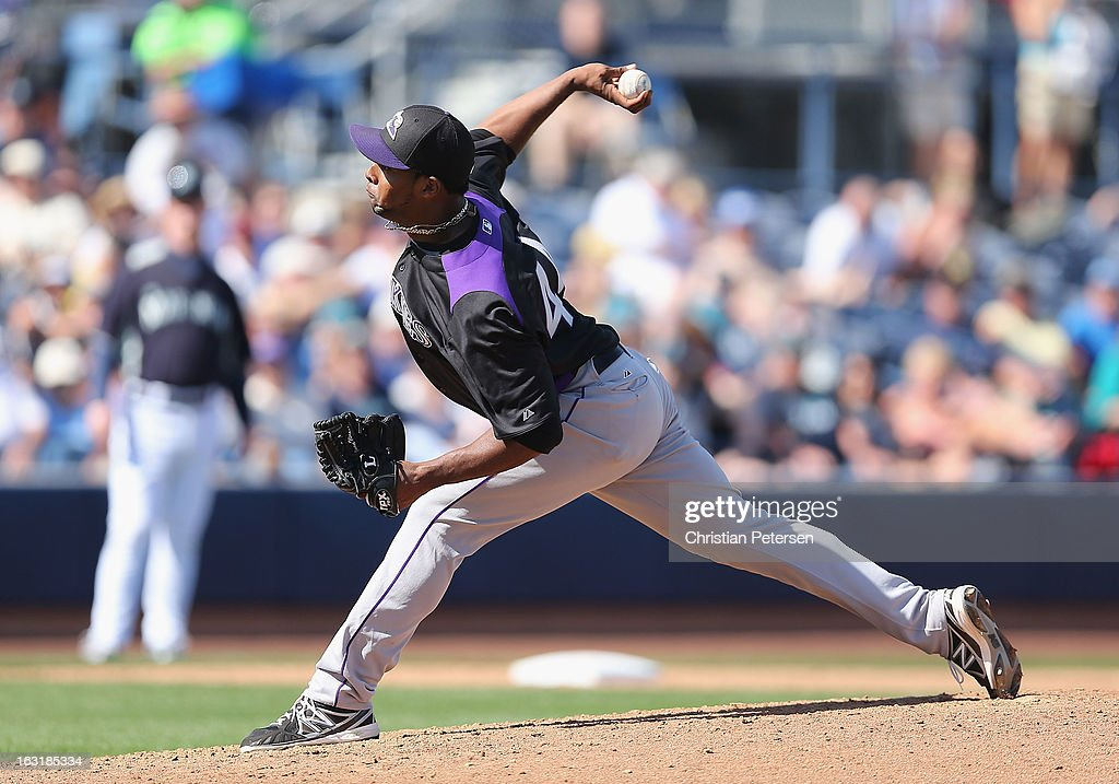 Relief pitcher Juan Nicasio #44 of the Colorado Rockies pitches against the Seattle Mariners during the spring training game at Peoria Stadium on March 4, 2013 in Peoria, Arizona.