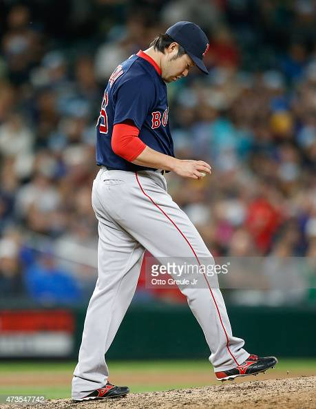 Relief pitcher Junichi Tazawa of the Boston Red Sox pauses on the mound against the Seattle Mariners in the ninth inning at Safeco Field on May 15...