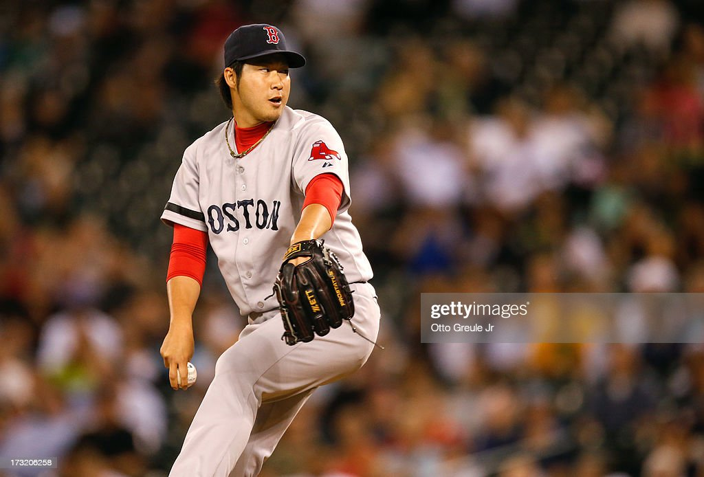 Relief pitcher <a gi-track='captionPersonalityLinkClicked' href=/galleries/search?phrase=Junichi+Tazawa&family=editorial&specificpeople=4624306 ng-click='$event.stopPropagation()'>Junichi Tazawa</a> #36 of the Boston Red Sox pitches against the Seattle Mariners at Safeco Field on July 9, 2013 in Seattle, Washington.