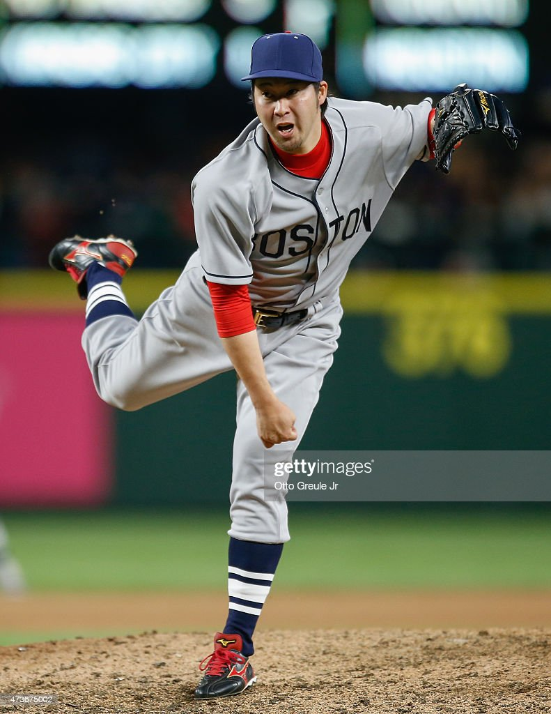 Relief pitcher Junichi Tazawa #36 of the Boston Red Sox pitches against the Seattle Mariners in the eighth inning at Safeco Field on May 16, 2015 in Seattle, Washington.