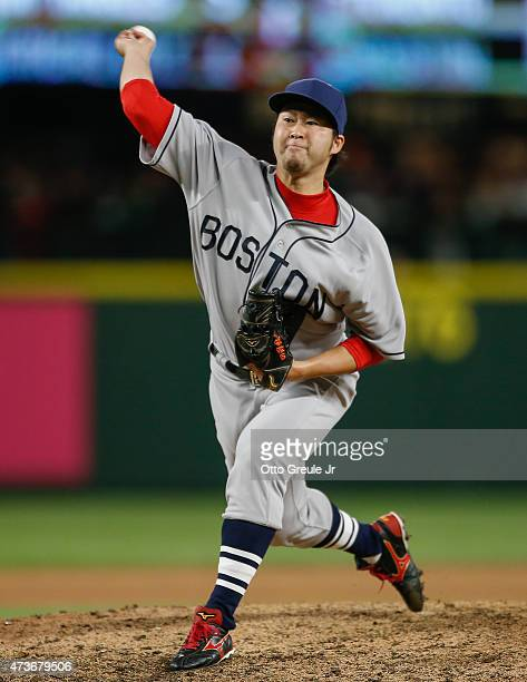 Relief pitcher Junichi Tazawa of the Boston Red Sox pitches against the Seattle Mariners in the eighth inning at Safeco Field on May 16 2015 in...