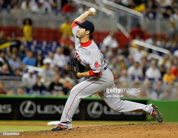 Relief pitcher Junichi Tazawa of the Boston Red Sox throws in the ninth inning against the Miami Marlins at Marlins Park on August 11 2015 in Miami...