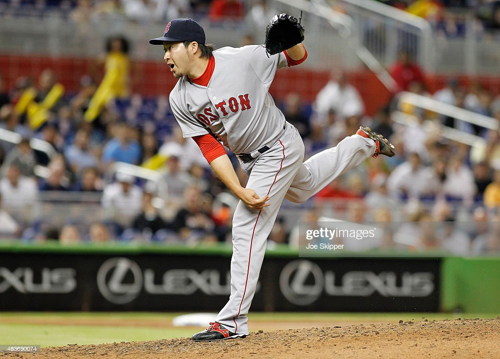Relief pitcher Junichi Tazawa #36 of the Boston Red Sox throws in the ninth inning against the Miami Marlins at Marlins Park on August 11, 2015 in Miami, Florida.
