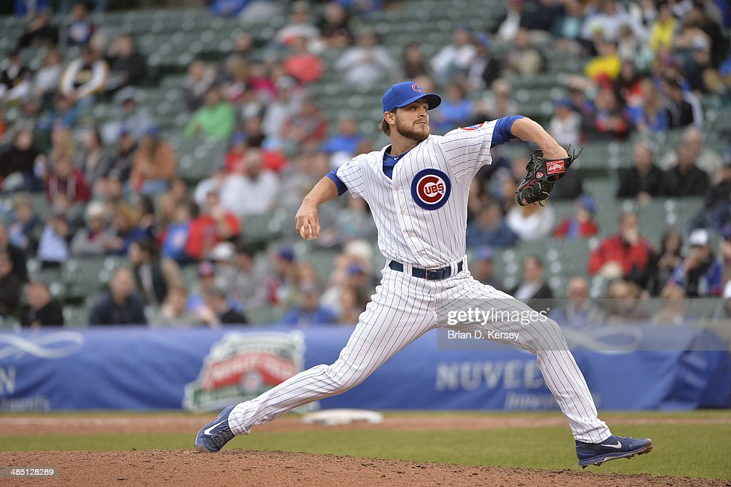 Relief pitcher Justin Grimm of the Chicago Cubs delivers during the eighth inning against the Pittsburgh Pirates at Wrigley Field on April 10 2014 in...