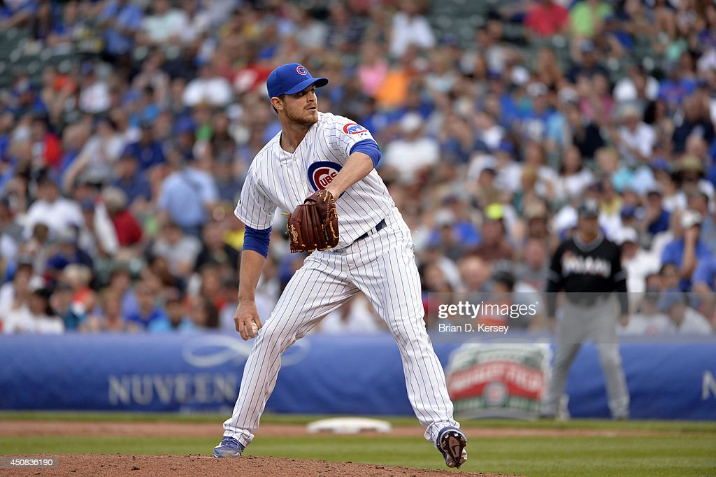 Relief pitcher Justin Grimm of the Chicago Cubs gets a ball during the eighth inning against the Miami Marlins at Wrigley Field June 7 2014 in...