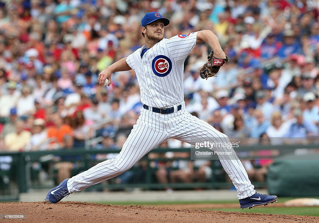 Relief pitcher Justin Grimm of the Chicago Cubs pitches against the Arizona Diamondbacks during the spring training game at Cubs Park on February 27...