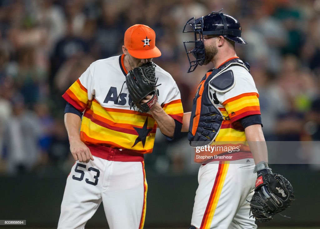 Relief pitcher Ken Giles #53 of the Houston Astros and catcher Brian McCann #16 of the Houston Astros meet at the mound after loading up the bases during the ninth inning of a game against the Seattle Mariners at Safeco Field on June 24, 2017 in Seattle, Washington. The Astros won 5-2.