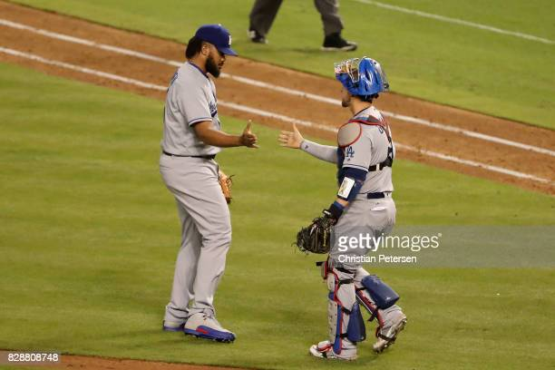Relief pitcher Kenley Jansen of the Los Angeles Dodgers celebrates with catcher Yasmani Grandal after defeating the Arizona Diamondbacks 32 in the...