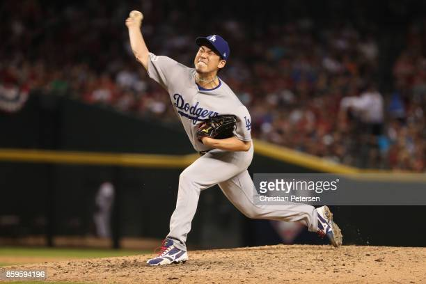 Relief pitcher Kenta Maeda of the Los Angeles Dodgers throws during the eighth inning of the National League Divisional Series game three against the...
