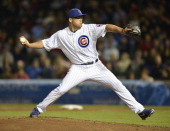 Relief pitcher Kevin Gregg of the Chicago Cubs delivers during the ninth inning against the St Louis Cardinals on May 7 2013 at Wrigley Field in...