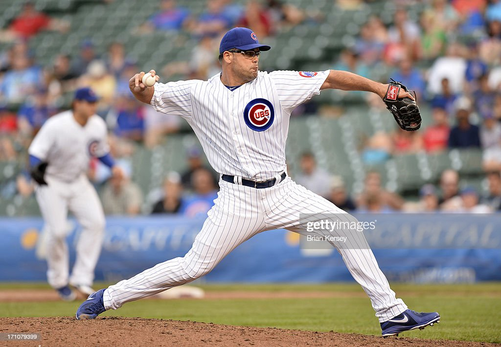 Relief pitcher <a gi-track='captionPersonalityLinkClicked' href=/galleries/search?phrase=Kevin+Gregg&family=editorial&specificpeople=240417 ng-click='$event.stopPropagation()'>Kevin Gregg</a> #63 of the Chicago Cubs delivers during the ninth inning against the Houston Astros at Wrigley Field on June 21, 2013 in Chicago, Illinois. The Cubs defeated the Astros 3-1.