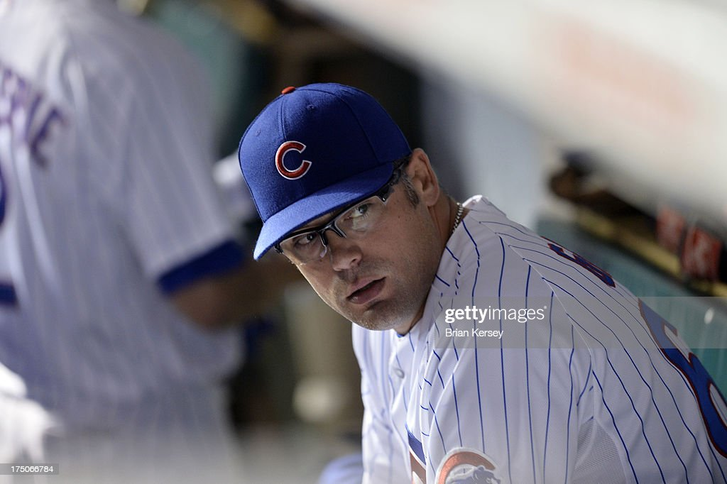 Relief pitcher <a gi-track='captionPersonalityLinkClicked' href=/galleries/search?phrase=Kevin+Gregg&family=editorial&specificpeople=240417 ng-click='$event.stopPropagation()'>Kevin Gregg</a> #63 of the Chicago Cubs sits in the dugout after blowing a save in the ninth inning of game two of a double header against the Milwaukee Brewers at Wrigley Field on July 30, 2013 in Chicago, Illinois. The Brewers defeated the Cubs 3-2.
