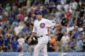 Relief pitcher Kevin Gregg of the Chicago Cubs stands on the mound against the Chicago White Sox at Wrigley Field on May 30 2013 in Chicago Illinois...