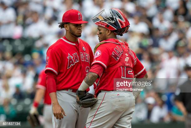 Relief pitcher Keynan Middleton of the Los Angeles Angels of Anaheim and catcher Martin Maldonado of the Los Angeles Angels of Anaheim meet at the...