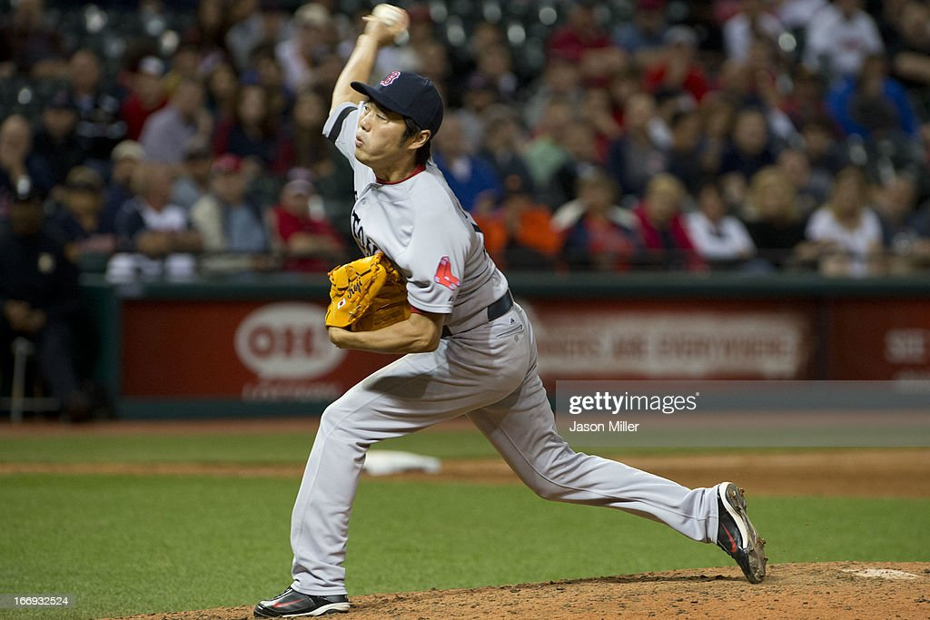Relief pitcher <a gi-track='captionPersonalityLinkClicked' href=/galleries/search?phrase=Koji+Uehara&family=editorial&specificpeople=801278 ng-click='$event.stopPropagation()'>Koji Uehara</a> #19 of the Boston Red Sox pitches during the eighth inning against the Cleveland Indians at Progressive Field on April 18, 2013 in Cleveland, Ohio.