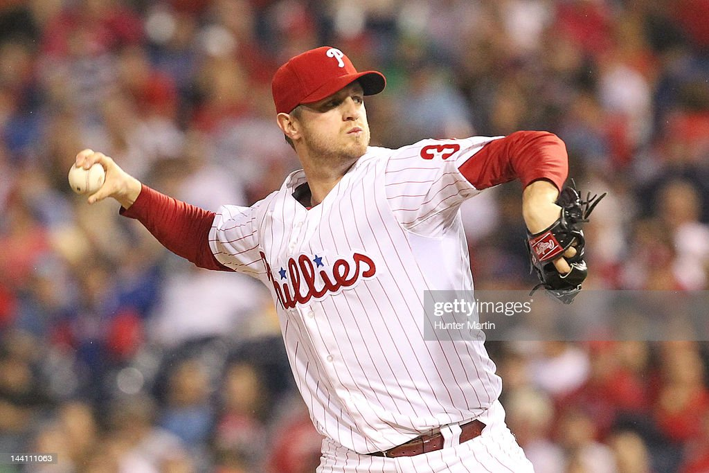 Relief pitcher <a gi-track='captionPersonalityLinkClicked' href=/galleries/search?phrase=Kyle+Kendrick&family=editorial&specificpeople=4365300 ng-click='$event.stopPropagation()'>Kyle Kendrick</a> #38 of the Philadelphia Phillies throws a pitch during a game against the New York Mets at Citizens Bank Park on May 9, 2012 in Philadelphia, Pennsylvania. The Mets won 10-6.