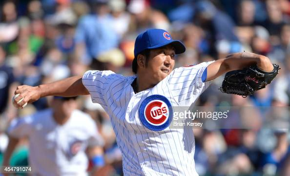 Relief pitcher Kyuji Fujikawa of the Chicago Cubs delivers a pitch during the eleventh inning against the Pittsburgh Pirates at Wrigley Field on...