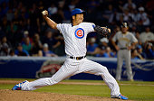 Relief pitcher Kyuji Fujikawa of the Chicago Cubs delivers a pitch during the eighth inning against the Pittsburgh Pirates at Wrigley Field on...