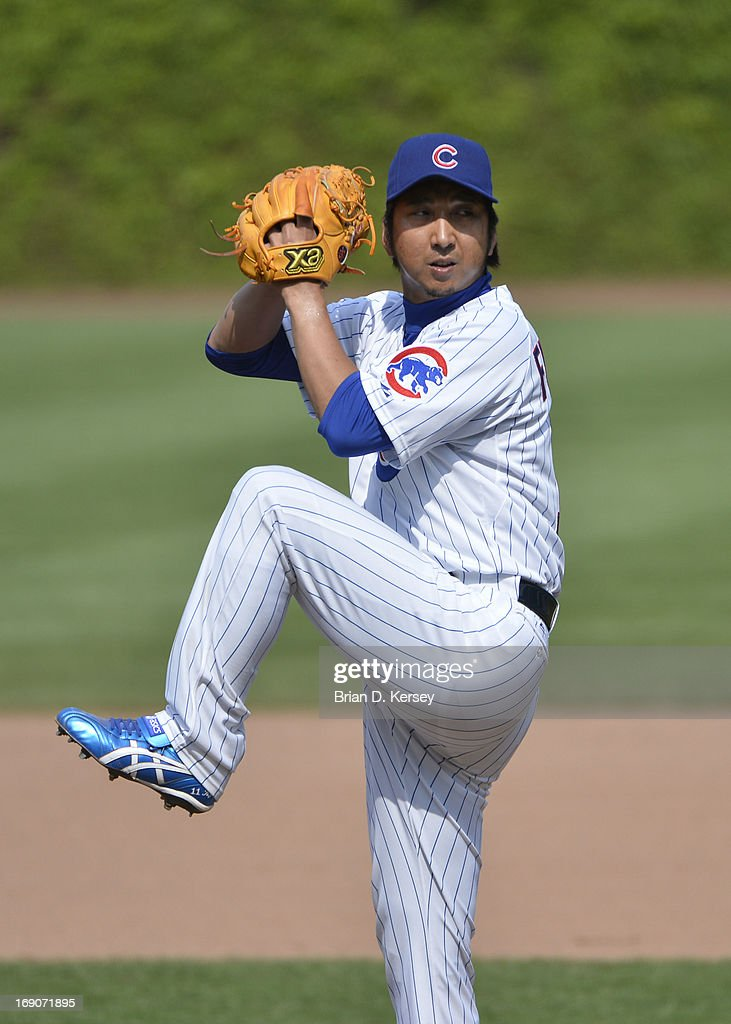 Relief pitcher Kyuji Fujikawa #11 of the Chicago Cubs pitches during the eighth inning against the New York Mets on May 19, 2013 at Wrigley Field in Chicago, Illinois. Fujikawa gave up a solo home run to Daniel Murphy #28 of the New York Mets and received the loss. The Mets defeated the Cubs 4-3.