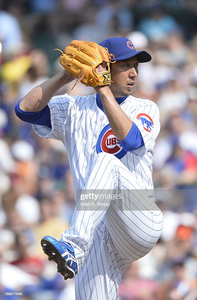 Relief pitcher <a gi-track='captionPersonalityLinkClicked' href=/galleries/search?phrase=Kyuji+Fujikawa&family=editorial&specificpeople=807185 ng-click='$event.stopPropagation()'>Kyuji Fujikawa</a> #11 of the Chicago Cubs pitches during the eighth inning against the New York Mets on May 19, 2013 at Wrigley Field in Chicago, Illinois. Fujikawa gave up a solo home run to Daniel Murphy #28 of the New York Mets and received the loss. The Mets defeated the Cubs 4-3.