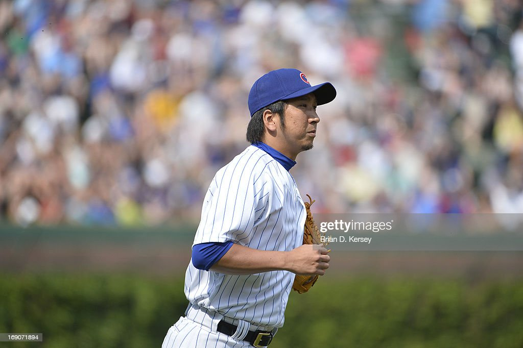 Relief pitcher Kyuji Fujikawa #11 of the Chicago Cubs runs in from the bullpen to pitch the eighth inning against the New York Mets on May 19, 2013 at Wrigley Field in Chicago, Illinois. Fujikawa gave up a solo home run to Daniel Murphy #28 of the New York Mets and received the loss. The Mets defeated the Cubs 4-3.