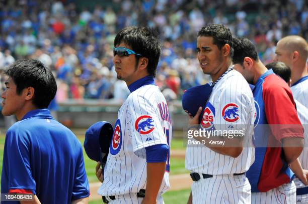 Relief pitcher Kyuji Fujikawa of the Chicago Cubs stands for the singing of 'The Star Spangled Banner' before the game against the New York Mets on...