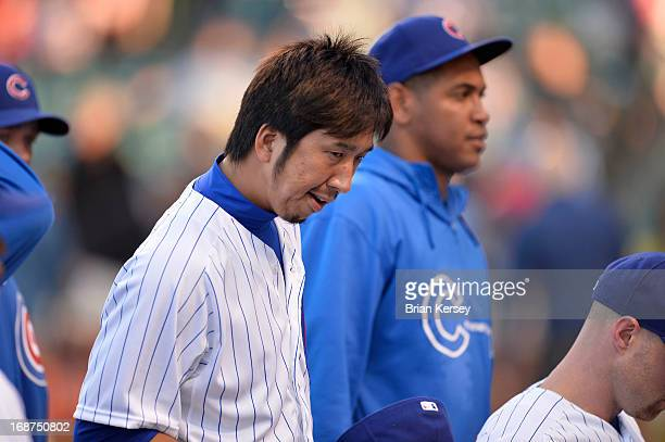 Relief pitcher Kyuji Fujikawa of the Chicago Cubs walks off the field after the singing of 'The Star Spangled Banner' before the game against the...