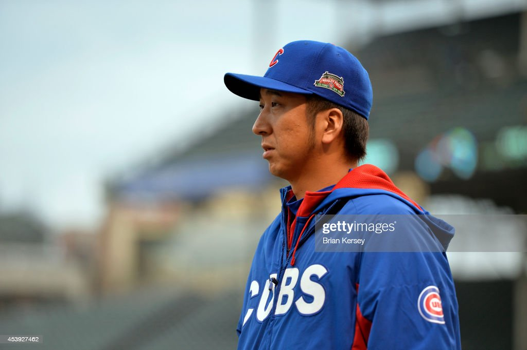 Relief pitcher <a gi-track='captionPersonalityLinkClicked' href=/galleries/search?phrase=Kyuji+Fujikawa&family=editorial&specificpeople=807185 ng-click='$event.stopPropagation()'>Kyuji Fujikawa</a> #11 of the Chicago Cubs walks out the the bullpen before the continuation of a resumed game against the San Francisco Giants at Wrigley Field on August 21, 2014 in Chicago, Illinois. The game was initially called off in the early morning hours of August 20 over a protest from the Giants. Major League Baseball accepted the Giants' appeal, ruling the delay was caused by a mechanical failure of the tarp and changing the status of the game from cancelled and completed with a Cubs 2-0 win to a suspended game. The Cubs defeated the Giants 2-1.