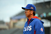Relief pitcher Kyuji Fujikawa of the Chicago Cubs walks out the the bullpen before the continuation of a resumed game against the San Francisco...