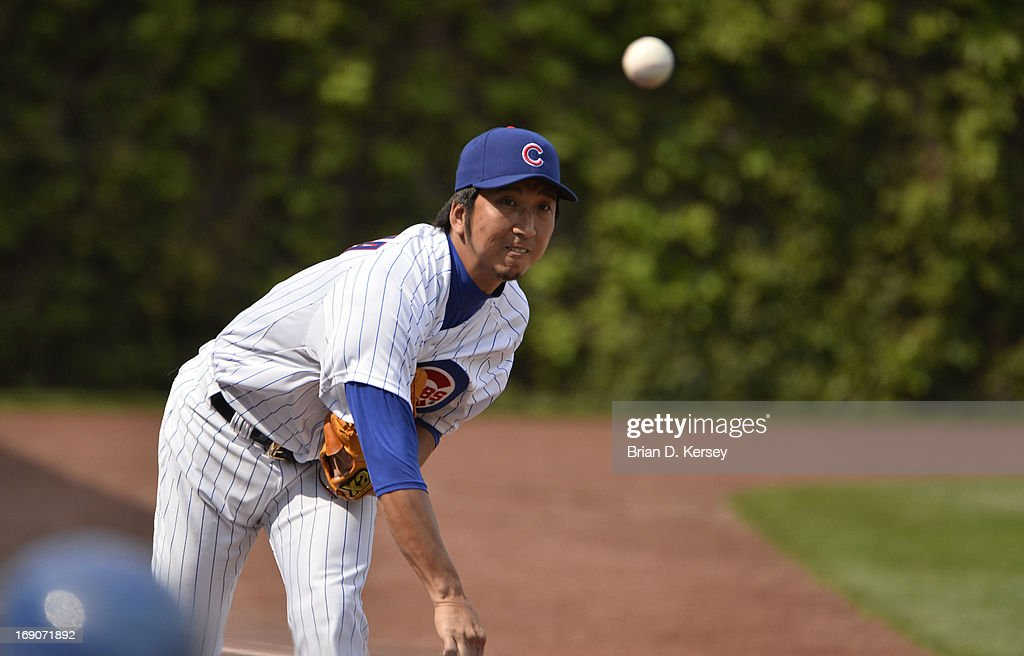 Relief pitcher Kyuji Fujikawa #11 of the Chicago Cubs warms up in the bullpen during the seventh inning against the New York Mets on May 19, 2013 at Wrigley Field in Chicago, Illinois. Fujikawa pitched the eighth inning giving up a solo home run to Daniel Murphy #28 of the New York Mets and receiving the loss. The Mets defeated the Cubs 4-3.