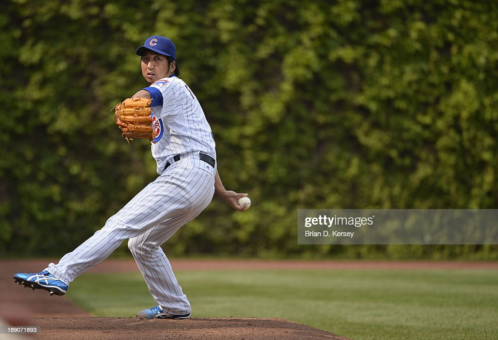 Relief pitcher <a gi-track='captionPersonalityLinkClicked' href=/galleries/search?phrase=Kyuji+Fujikawa&family=editorial&specificpeople=807185 ng-click='$event.stopPropagation()'>Kyuji Fujikawa</a> #11 of the Chicago Cubs warms up in the bullpen during the seventh inning against the New York Mets on May 19, 2013 at Wrigley Field in Chicago, Illinois. Fujikawa pitched the eighth inning giving up a solo home run to Daniel Murphy #28 of the New York Mets and receiving the loss. The Mets defeated the Cubs 4-3.