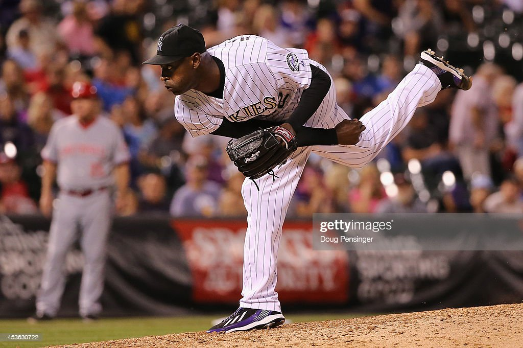 Relief pitcher LaTroy Hawkins of the Colorado Rockies delivers against the Cincinnati Reds at Coors Field on August 14 2014 in Denver Colorado The...