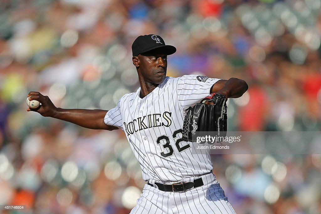 Relief pitcher LaTroy Hawkins of the Colorado Rockies delivers to home plate during the ninth inning against the Los Angeles Dodgers at Coors Field...
