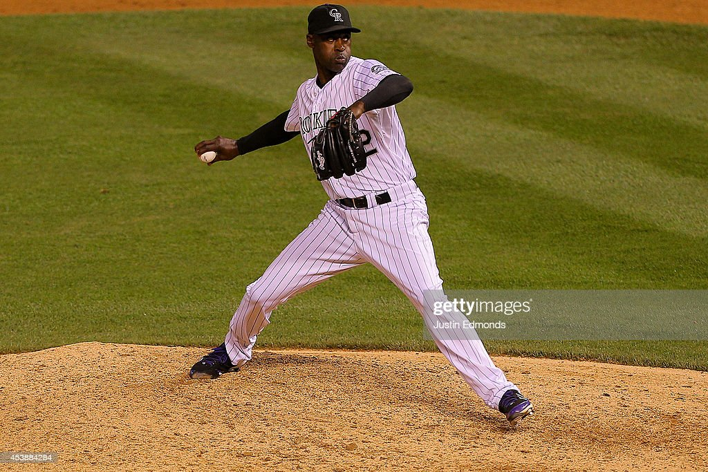 Relief pitcher <a gi-track='captionPersonalityLinkClicked' href=/galleries/search?phrase=LaTroy+Hawkins&family=editorial&specificpeople=204722 ng-click='$event.stopPropagation()'>LaTroy Hawkins</a> #32 of the Colorado Rockies delivers to home plate during the ninth inning against the Kansas City Royals at Coors Field on August 20, 2014 in Denver, Colorado. The Rockies defeated the Royals 5-2.