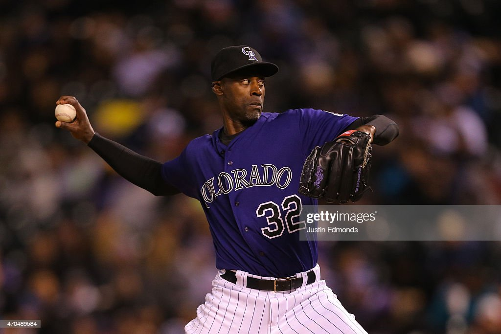 Relief pitcher LaTroy Hawkins of the Colorado Rockies delivers to home plate during the fifth inning against the San Diego Padres at Coors Field on...