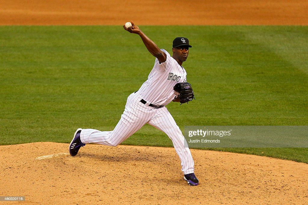 Relief pitcher LaTroy Hawkins of the Colorado Rockies delivers to home plate during the seventh inning against the Atlanta Braves at Coors Field on...