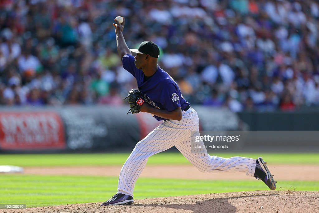 Relief pitcher LaTroy Hawkins of the Colorado Rockies delivers to home plate during the ninth inning against the Atlanta Braves at Coors Field on...