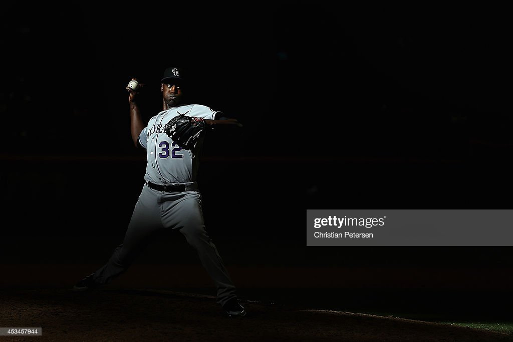 Relief pitcher LaTroy Hawkins #32 of the Colorado Rockies pitches against the Arizona Diamondbacks during the tenth inning of the MLB game at Chase Field on August 10, 2014 in Phoenix, Arizona. The Rockies defeated the Diamondbacks 5-3 in 10 innings.