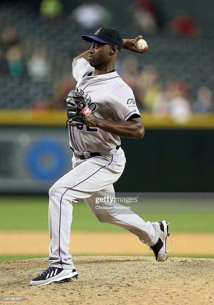 Relief pitcher <a gi-track='captionPersonalityLinkClicked' href=/galleries/search?phrase=LaTroy+Hawkins&family=editorial&specificpeople=204722 ng-click='$event.stopPropagation()'>LaTroy Hawkins</a> #32 of the Colorado Rockies pitches against the Arizona Diamondbacks during the MLB game at Chase Field on April 29, 2014 in Phoenix, Arizona. The Rockies defeated the Diamondbacks 5-4.