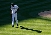 Relief pitcher LaTroy Hawkins of the Colorado Rockies walks off the mound in the ninth inning against the Chicago Cubs at Coors Field on April 12...