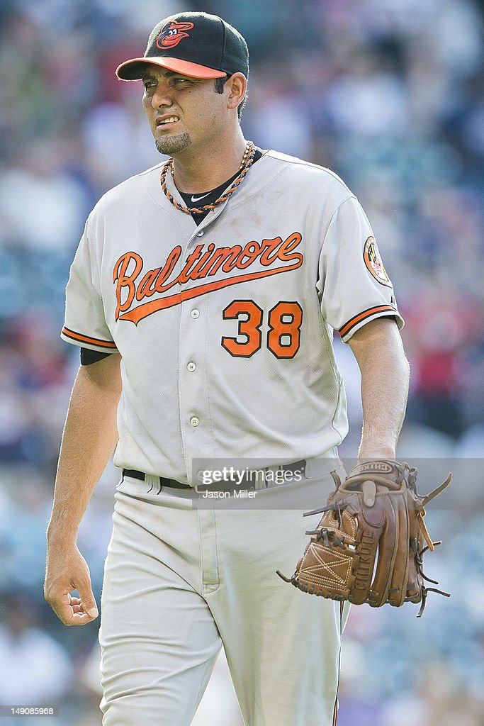 Relief pitcher <a gi-track='captionPersonalityLinkClicked' href=/galleries/search?phrase=Luis+Ayala&family=editorial&specificpeople=209039 ng-click='$event.stopPropagation()'>Luis Ayala</a> #38 of the Baltimore Orioles reacts as he leaves the game after giving up a two-run home run to Carlos Santana #41 (not shown) of the Cleveland Indians during the ninth inning at Progressive Field on July 22, 2012 in Cleveland, Ohio. The Orioles defeated the Indians 4-3.
