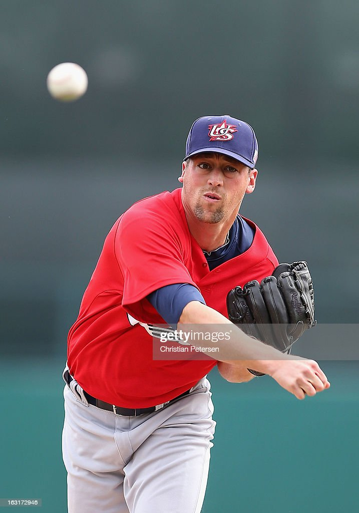 Relief pitcher <a gi-track='captionPersonalityLinkClicked' href=/galleries/search?phrase=Luke+Gregerson&family=editorial&specificpeople=5798819 ng-click='$event.stopPropagation()'>Luke Gregerson</a> #57 of Team USA pitches against the Chicago White Sox during the spring training game at Camelback Ranch on March 5, 2013 in Glendale, Arizona.