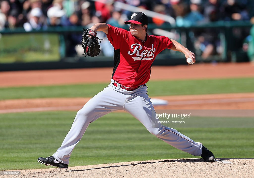 Relief pitcher <a gi-track='captionPersonalityLinkClicked' href=/galleries/search?phrase=Manny+Parra&family=editorial&specificpeople=4175286 ng-click='$event.stopPropagation()'>Manny Parra</a> #43 of the Cincinnati Reds pitches against the Cleveland Indians during the spring training game at Goodyear Ballpark on February 24, 2013 in Goodyear, Arizona
