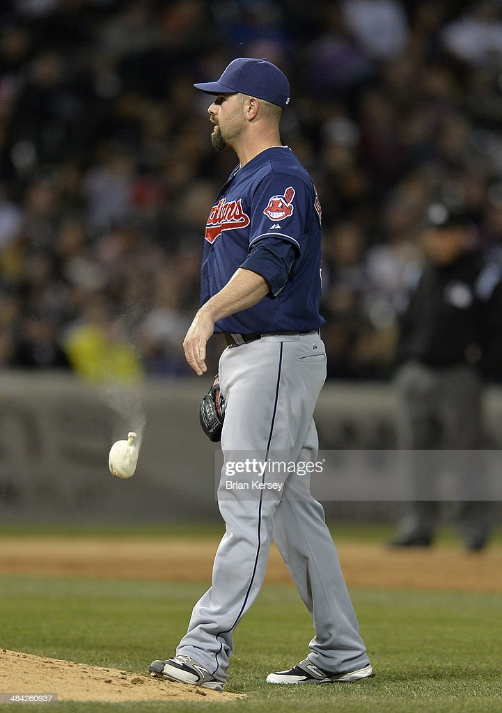 Relief pitcher <a gi-track='captionPersonalityLinkClicked' href=/galleries/search?phrase=Marc+Rzepczynski&family=editorial&specificpeople=6134203 ng-click='$event.stopPropagation()'>Marc Rzepczynski</a> #35 of the Cleveland Indians throws the rosin bag after walking in a run during the fifth inning against the Chicago White Sox at U.S. Cellular Field on April 11, 2014 in Chicago, Illinois. Rzepczynski walked Dayan Viciedo scoring Marcus Semien.