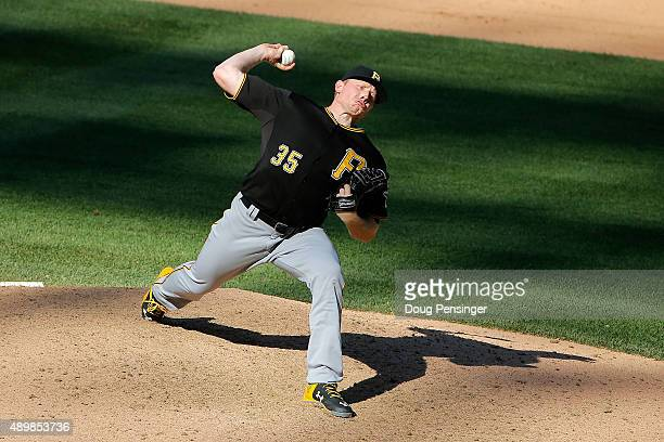 Relief pitcher Mark Melancon of the Pittsburgh Pirates delivers against the Colorado Rockies and earns a save in the Pirates 54 vicotry at Coors...