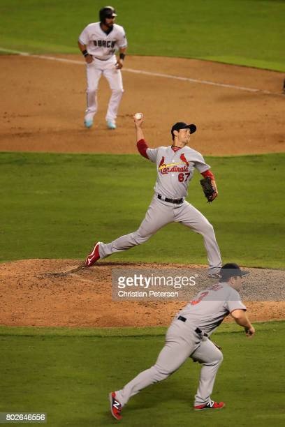 Relief pitcher Matt Bowman of the St Louis Cardinals pitches against the Arizona Diamondbacks during the 10th inning of the MLB game at Chase Field...