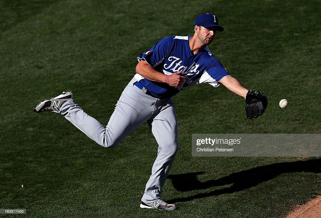 Relief pitcher Matt Torra #43 of Italy flips the ball to first base for an out during the World Baseball Classic First Round Group D game against Mexico at Salt River Fields at Talking Stick on March 7, 2013 in Scottsdale, Arizona. Italy defeated Mexico 6-5.