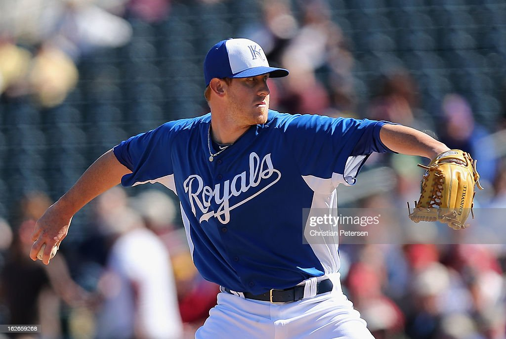 Relief pitcher Nate Adcock #47 of the Kansas City Royals pitches against the Arizona Diamondbacks during the spring training game at Surprise Stadium on February 25, 2013 in Surprise, Arizona.