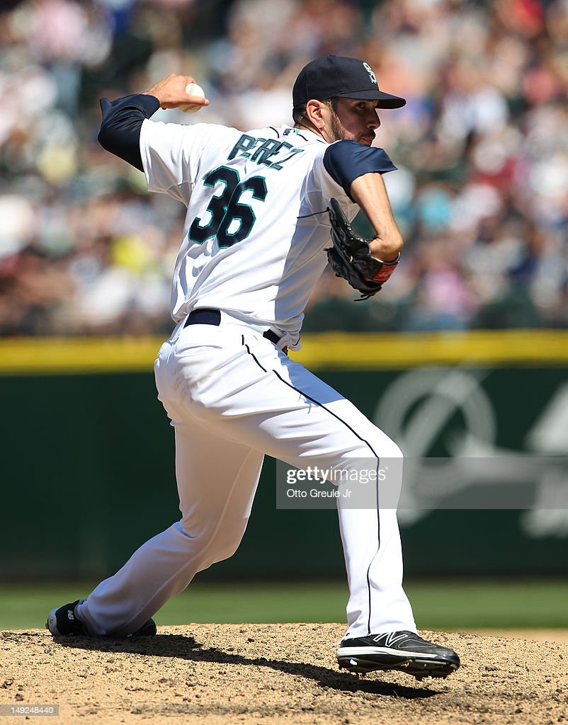 Relief pitcher Oliver Perez #36 of the Seattle Mariners pitches against the New York Yankees at Safeco Field on July 25, 2012 in Seattle, Washington. The Yankees defeated the Mariners 5-2.